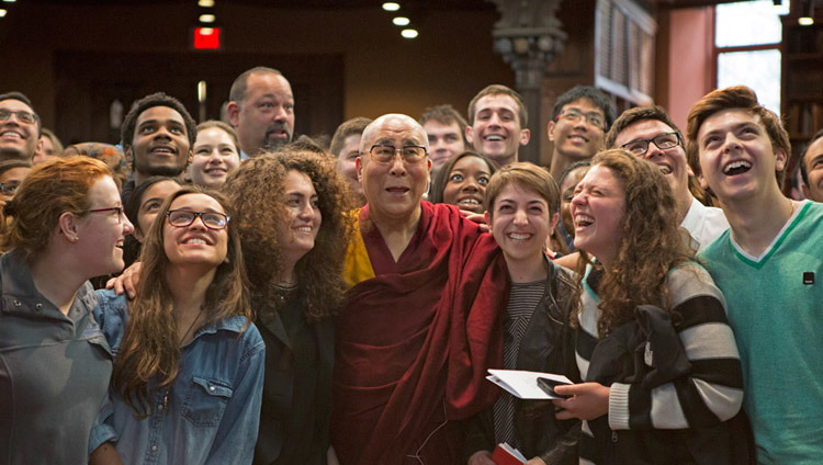 His Holiness the Dalai Lama poses for photos after his interactive session with students at Princeton University's Chancellor Green Library in Princeton, New Jersey on October 28, 2014. (Photo by Denise Applewhite)
